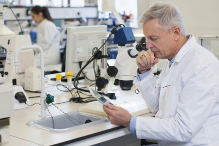 male-scientist-using-tablet-computer-in-laboratory